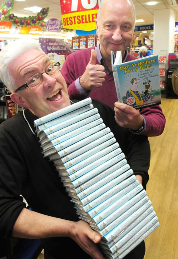 Yorkshire poet and author Ian McMillan and illustrator Tony Husband at WH Smith in York with copies of their book, Daft Yorkshire Fairy Tales