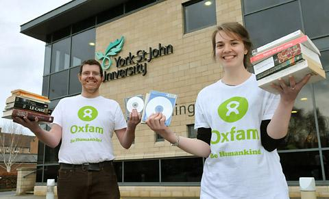 John McKay and Isabel Wilkinson from the Oxfam shop in Low Petergate  collect books and CDs at York St Johns University