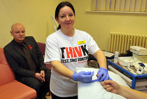 Tina Ramsey, one of the senior sisters, carries out an HIV test at Monkgate clinic watched by MESMAC chief executive Tom Doyle