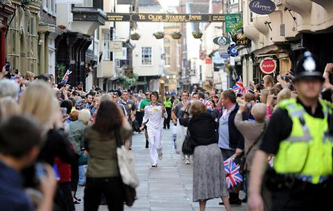 The Olympic torch passes through the streets of York, carried by Daniel Rodwell