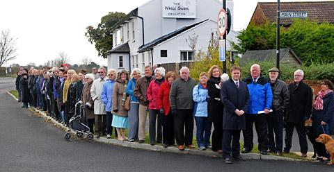 Villagers queue in Deighton to show their support for the lowering of the speed limit though the village