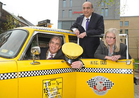 The Lord Mayor of York, Coun Keith Hyman, at the wheel of a New York-style taxi, with Kishor Majitha, managing director of Avantis Hotels, and Victoria Burnham, the general manager of Hampton by Hilton York