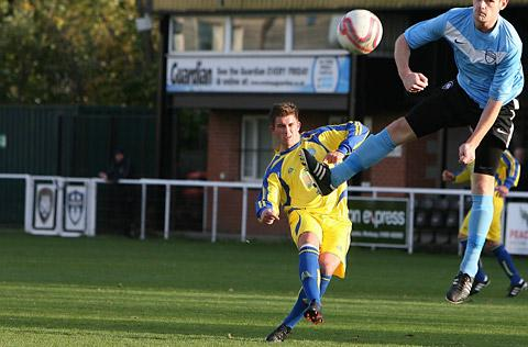 Pickering Town's John Heads, who is pictured bending in a free-kick, provided the turning point in the Pikes' derby duel delight over Tadcaster Albion with his timely  goal-saving challenge. Picture: Gordon Clayton
