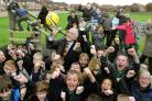 Harry Gration enjoys a game of football with pupils at Yearsley Grove Primary School after opening their new playground