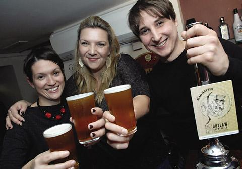 From the left, Suzy Garraghan, tea buyer for Taylors of Harrogate, beer writer Melissa Cole and Oliver Fozard, Outlaw Brewing's head brewer, raise a glass to the new  collaboration with Taylors of Harrogate