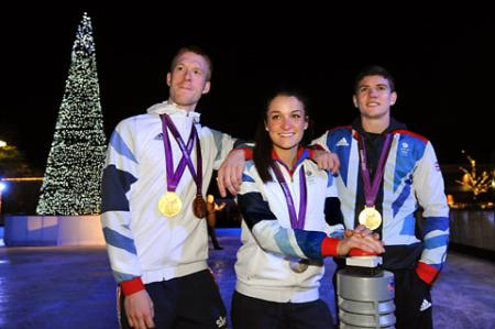 Olympians Ed Clancey, left, Lizzie Armitstead, and Luke Campbell, who turned on the Christmas tree lights to mark the opening of the York Designer Outlet Winter Wonderland