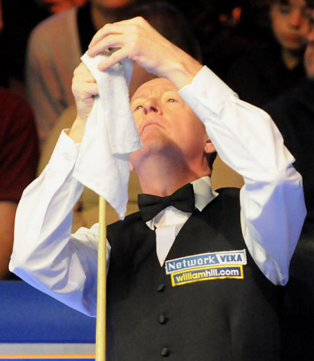 ormer world champion Steve Davis raises the white flag in his 2011 York defeat by Ronnie O'Sullivan, but he is through to the Barbican stages of this year's UK Championship