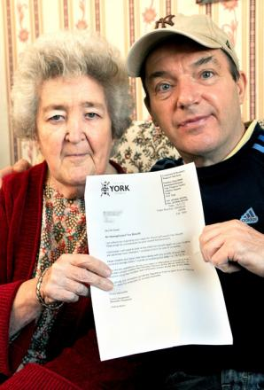Kathleen Russell and son David, of Peter Hill Drive, Clifton, with the letter from City of York Council sent in error
