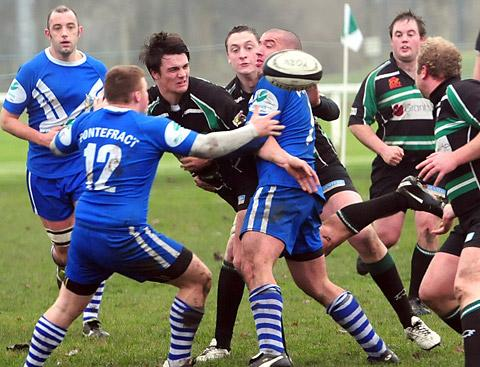 York RUFC's Lewis Hannibal is surrounded by Pontefract tacklers as the ball comes loose in  his side's 23-12  victory in Yorkshire One at Clifton  Park on Saturday