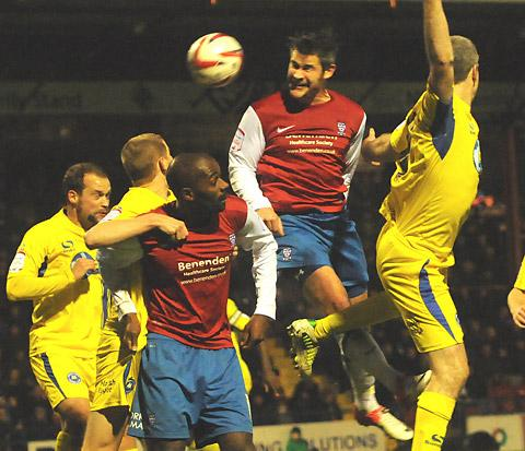 York City striker Jamie Reed heads wide of the Torquay United goal in Saturday's 2-0 defeat  at Bootham Crescent