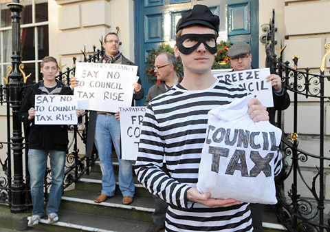 Council tax rise 'daylight robbery', protesters claim