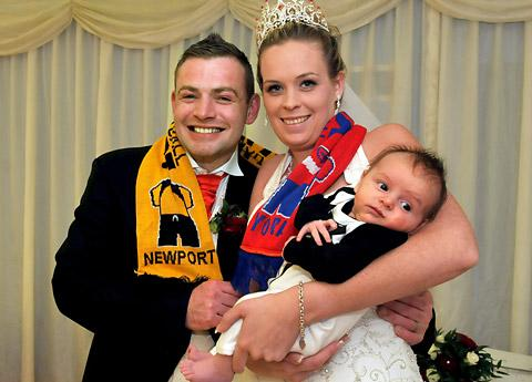Bride and groom Jamie Innes and Carly Lewis with their son Liam at the Regen Centre in Riccall