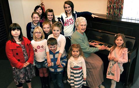 Ethel Richardson, aged 88, who has played the piano at the Barbara Taylor dance school for nearly 30 years, with some of her pupils at Strensall Village Hall