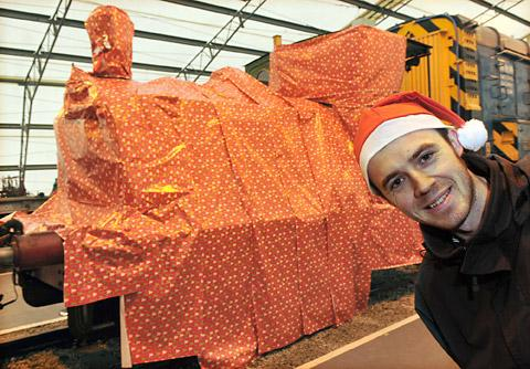 Noel Hartley with Teddy the steam train all wrapped up for Christmas at the National Railway Museum