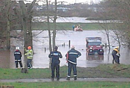 The scene as a woman is rescued on Clifton Ings after being cut off by water
