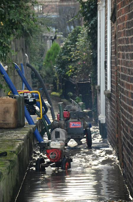 Pumps at work in a lane alongside Tower Gardens.