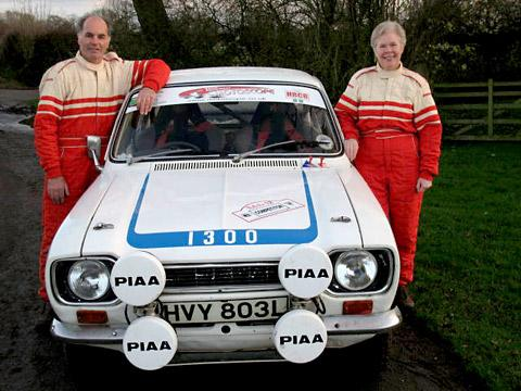York Press: Husband and wife team Stuart and Linda Cariss and their trusty 1300cc Ford Escort which they steered to success for the third consecutive year in the Roger Albert Clark Rally