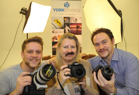 Sam Whitton and Beverley and David Kirkham, at York Studios, prepare to focus on Movember moustaches to raise money for the cause