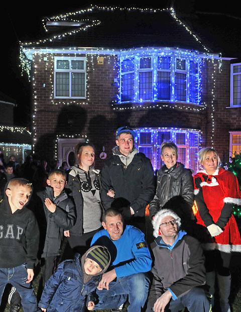 Christmas lights are switched on at 29 Hamilton Drive, Holgate, York, to raise money for the Riley Plant Fund. pictured: home owners and organisers Nicola Casey, right, and husband Tony, front centre, with Riley's grandmother Simone Potter, second right