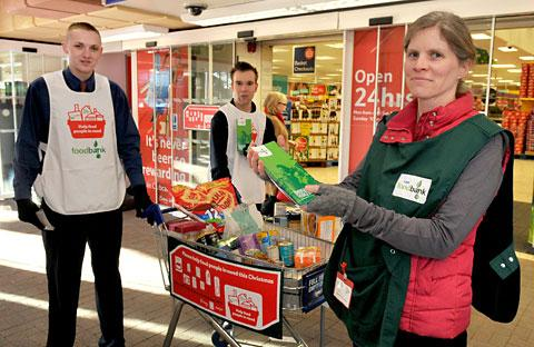 Jenny Sharp, of the Food Bank, with Tesco staff Tom Foley, left, and Sam Birch at Tesco's Askham Bar store
