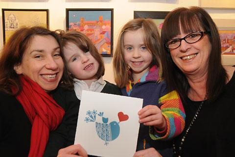Emma Taylor, left, and her daughters Juliet and Ella with artist Giuliana Lazzerini, who has adapted on of her card designs to support the girls' fundraising efforts for the Juliet Braveheart Appeal