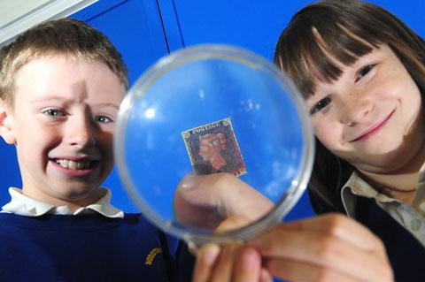Sam Robinson and Molly Cooper, of Woodthorpe school, with the Penny Black stamp