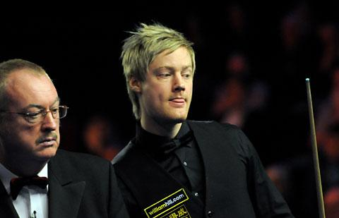 Neil Robertson peers over the shoulder of referee Eirian Williams