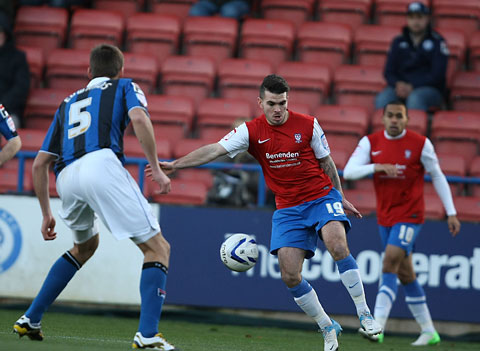Two-goal York City midfielder Michael Potts  takes on Rochdale's Ryan Edwards in Saturday's 3-2 win at Spotland. The game was a rare chance for Potts to impress in a City shirt after a  long spell on the sideline. Picture: Gordon Clayton