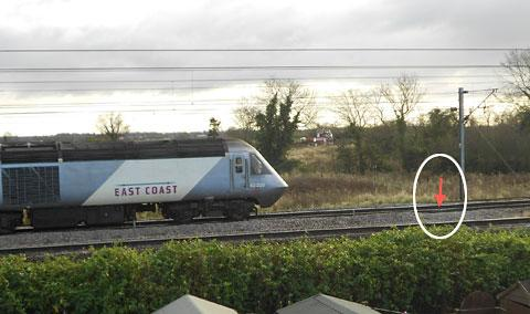 An East Coat train heads towards the broken rail at Copmanthorpe, York, arrowed