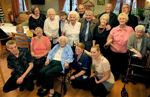 Gertrude Moor, in blue in the centre, celebrates her 100th birthday with friends and family at Marjorie Waite Court yesterday