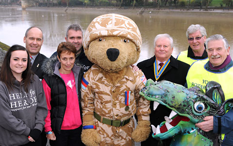 BEARING UP: Pictured with the charity's mascot, Hero Bear, are, from left, Helen Loynes, Tony Eaton and Jeanette and St