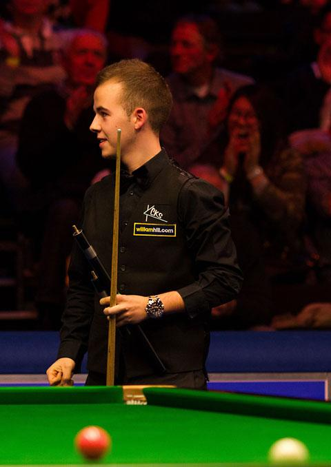 Belgian teenager Luca Brecel celebrates his 6-4 victory over Mark King at the Barbican in York