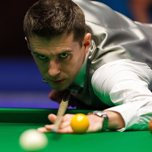 Mark Selby, pictured, sealed a 6-4 victory over Neil Robertson to reach the williamhill.com UK Championship semi-finals