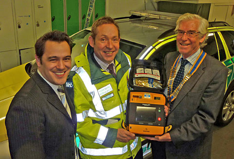 Mark Inman, centre, receives the first defibrillator from Tom Smith of D E Ford, left, and Tony Botting, president of York Vikings Rotary Club