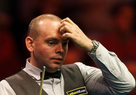 Stuart Bingham's tournament ended in a 6-4 defeat  to Ali Carter