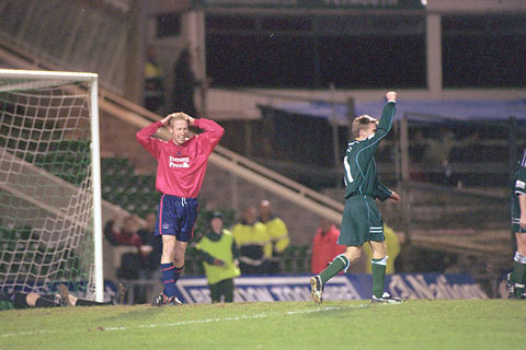 Plymouth Argyle's Martin Phillips celebrates after York City defender Graham Potter, left, nets an own goal in a 1-0 defeat at Home Park in 2002