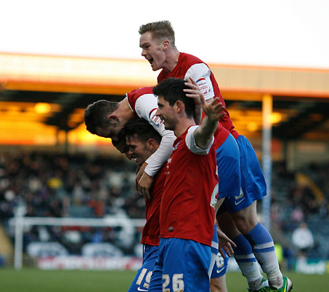 York City players leap on goalscorer Michael Potts during last weekend's 3-2 victory at Rochdale – the latest in a long line of away successes for the Minstermen under manager Gary Mills