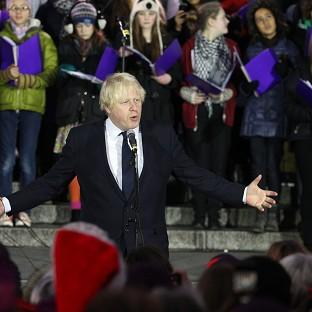 London Mayor Boris Johnson speaks at a Christmas carol concert held in Trafalgar Square to thank the London Olympic 2012 volunteers