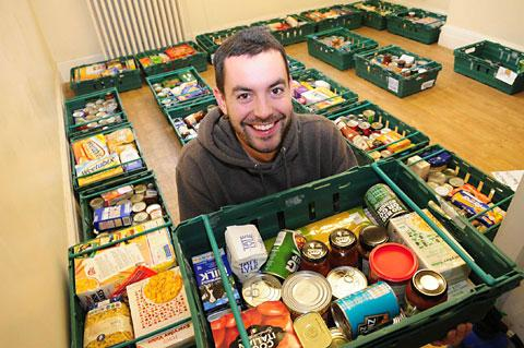 Caleb Ellwood with food donated to the York Foodbank.