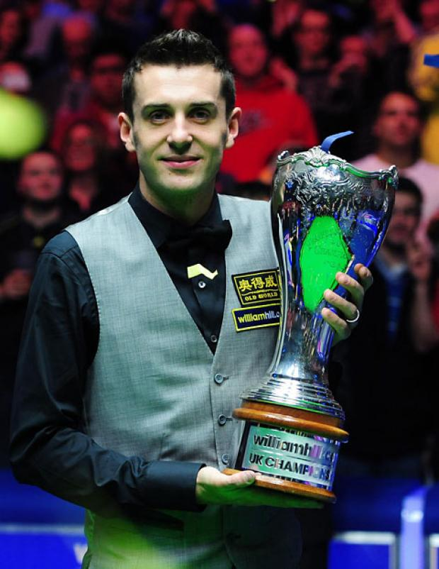 Mark Selby lifts the williamhill.com UK Snooker Championship trophy after beating Shaun Murphy 10-6 in the final at York's Barbican