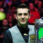 Mark Selby lifts the williamhill.com UK Snooker Championship trophy after beating Shaun Murphy 10-6 in the final at York's Barbican last night
