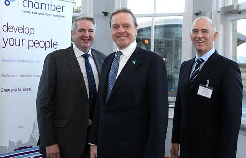James Lambert, chief executive of R&R Ice Cream, front, with Richard Flanagan,  president of Leeds, York and North Yorkshire Chamber of Commerce, left, and Len Cruddas, chief executive of the chamber, at its annual dinner in York.