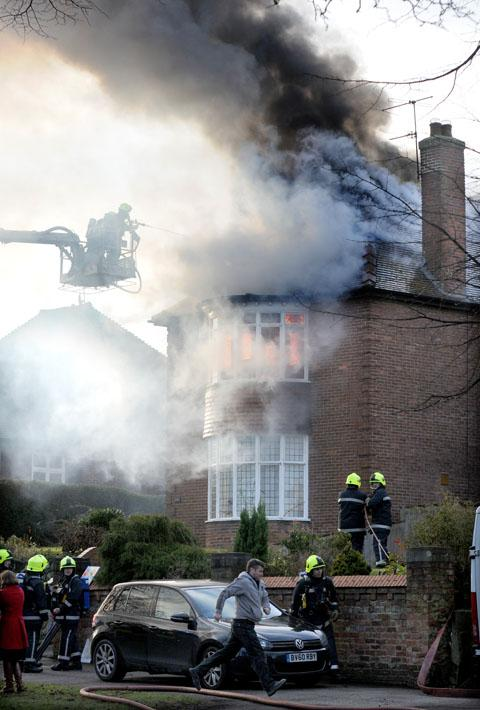 Firefighters tackling the house fire on Tadcaster Road
