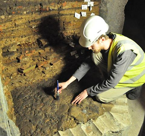 York Press: Ian Milstead Lead Archaeologist from YAT cleaning Roman Road beneath York Minster.