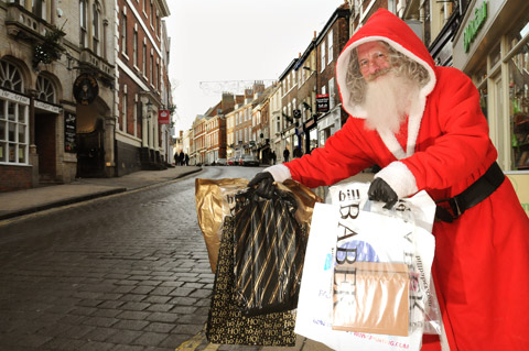 Father Christmas visits Micklegate in York to put the finishing touches to his Christmas shopping
