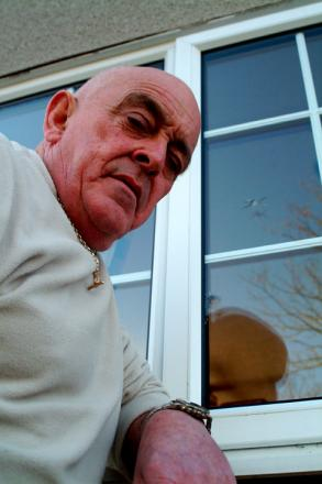 Paul Taylor with a damaged window at his home in Bondgate, Selby