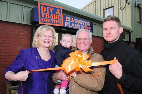 right, with his parents, Sue and Ken Garland, holding Tim's daughter, Izzy, at Elvington Plant Hire cut  the ribbon the  company's expansion
