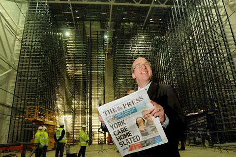 York Press: Steve Morris, of the British Library, reads The Press inside the new giant newspaper storage centre at Boston Spa