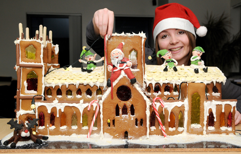 Jess Young of Minster Law with the gingerbread Minster.