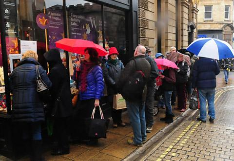 People queue outside Waterstones in High Ousegate, York, for the book signing by Ian Rankin